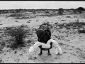 james-nachtwey-somalia-1992-lifting-a-dead-son-to-carry-him-to-a-mass-grave-during-the-famine